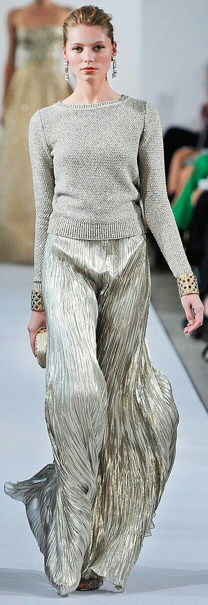 Yule style! Noel! Christmas and Holiday Season Parties!! Yes -- this is a great choice for a gorgeous Holiday Party outfit! Long Silver skirt and a sweater or Tee-shirt with sparkles! Plus matching cuffs on the wrist! Hair up and a great lipstick!