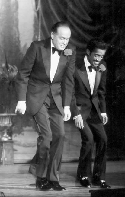 Bob Hope and Sammy Davis, Jr. dancing.
