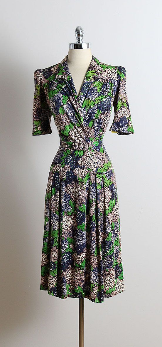 ➳ vintage 1940s dress  * colorful rayon * beautiful lilac print * detachable belt * metal side zipper  condition | excellent  fits like m/l  dress length 44 bodice 17 bust up to 40 waist 28-30  ➳ shop http://www.etsy.com/shop/millstreetvintage?ref=si_shop  ➳ shop policies http://www.etsy.com/shop/millstreetvintage/policy  twitter | MillStVintage facebook | millstreetvintage instagram | millstreetvintage  5714/1616