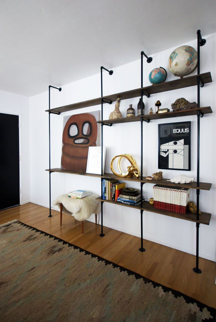 "DIY Shelving Unit: ""The project is great since it's totally accessible and customizable. You can pick up all the parts at any local hardware store and design the shelves it to fit any space. It's a big impact for a small investment of time and cash."""