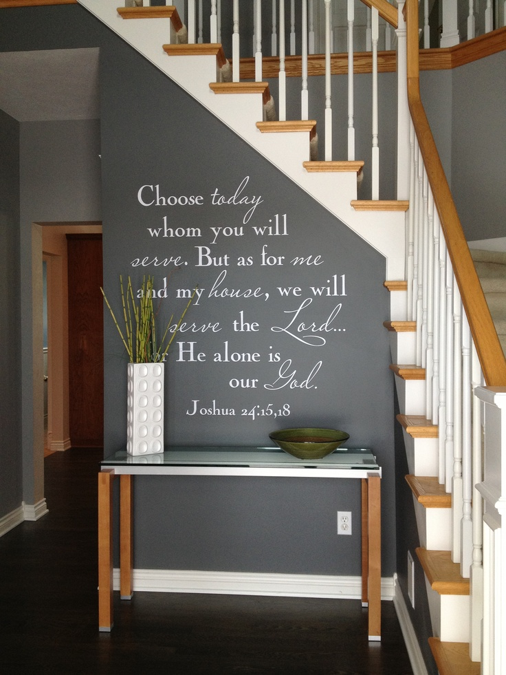 our entry way foyer with bible verse in white vinyl script and charcoal gray walls  surrounding