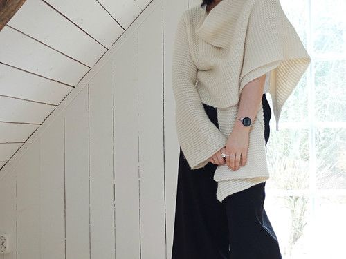 wrapped in cozy knit makes the outfit perfect for early spring or summer evening