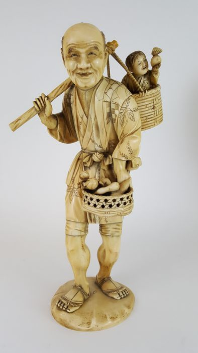 Catawiki online auction house: Large Okimono ivory figure of a farmer and child (33,5 cm) - Japan -  19th century