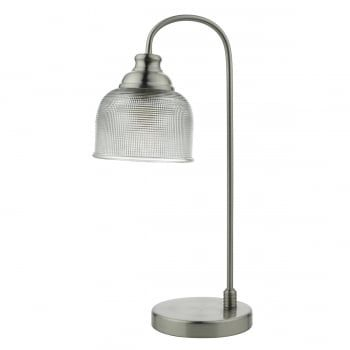 A retro table lamp in a satin nickel finish complete with a prismatic glass shade. The prismatic glass ensures a wide spread of glare free illumination. Complete with an in-line rocker switch. A modern lamp, with a vintage feel and a twist of industrial flair, this will compliment most settings.