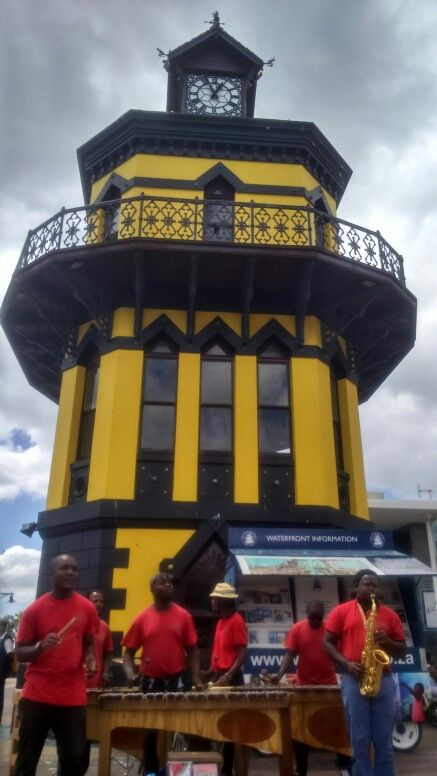 Street musicians in front of the yellow clock tower, V&A Waterfront,  Cape Town