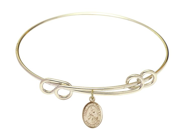 "8 1/2 inch Round Double Loop Bangle Bracelet w/ St. Maria Goretti medal charm. 8 1/2 inch Round Double Loop Bangle Bracelet with a St. Maria Goretti charm. St. Maria Goretti. 100% Handmade in the United States, Lifetime No-Tarnish Guarantee. Gold-Filled Medal. Brass bangle with ""Hamilton Gold"" gold plating."