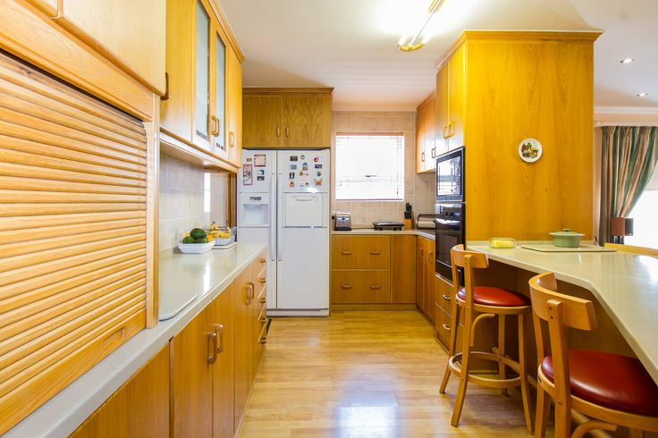 The kitchen which consists of lots of cupboard space and has a built-in oven and stove and hob. Off the kitchen is a sizeable wash room as well.