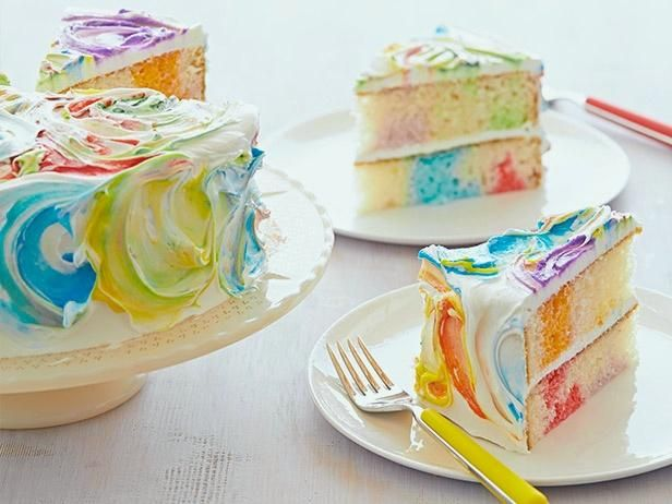 Rainbow Ribbon Cake : Party guests will be awestruck by the bright bursts of color on this stunning cake, but you don't have to tell them it's easier than it looks. For the rainbow effect, Sandra uses colored icing and a variety of gelatin flavors to stain the frosting and cake, respectively.