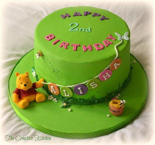 Winnie The Pooh Birthday Cake Alisha's 2nd birthday cake. Four layers of Vanilla sponge with Strawberry Conserve. Sugarpaste models
