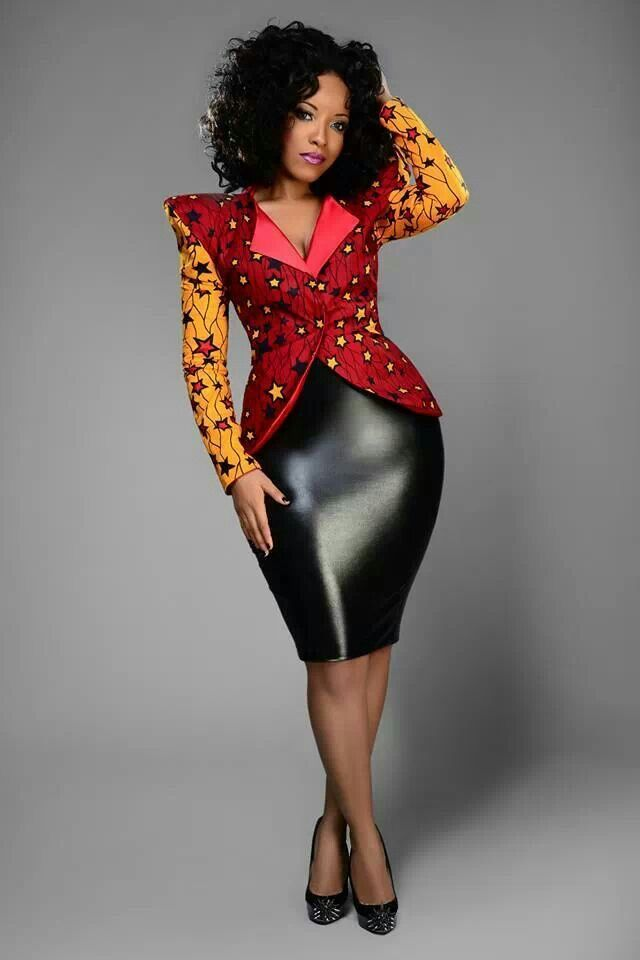 http://www.shorthaircutsforblackwomen.com/african-dresses/ Loving the combination of the leather and African print dress.