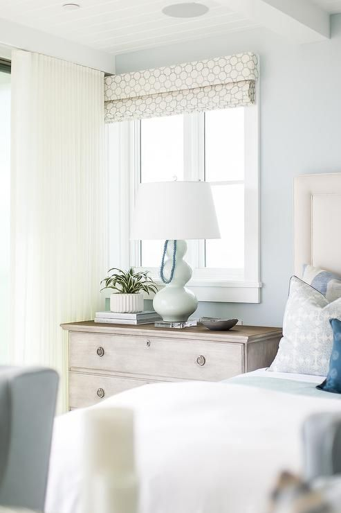 Restful Ivory And Blue Bedroom Is Fitted With An Ivory Headboard  Complementing A Bed Dressed In