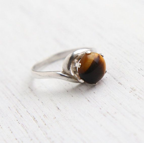 Hey, I found this really awesome Etsy listing at https://www.etsy.com/listing/172042090/vintage-sterling-silver-tigers-eye-ring