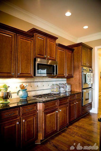dark cabinets + hard wood floor