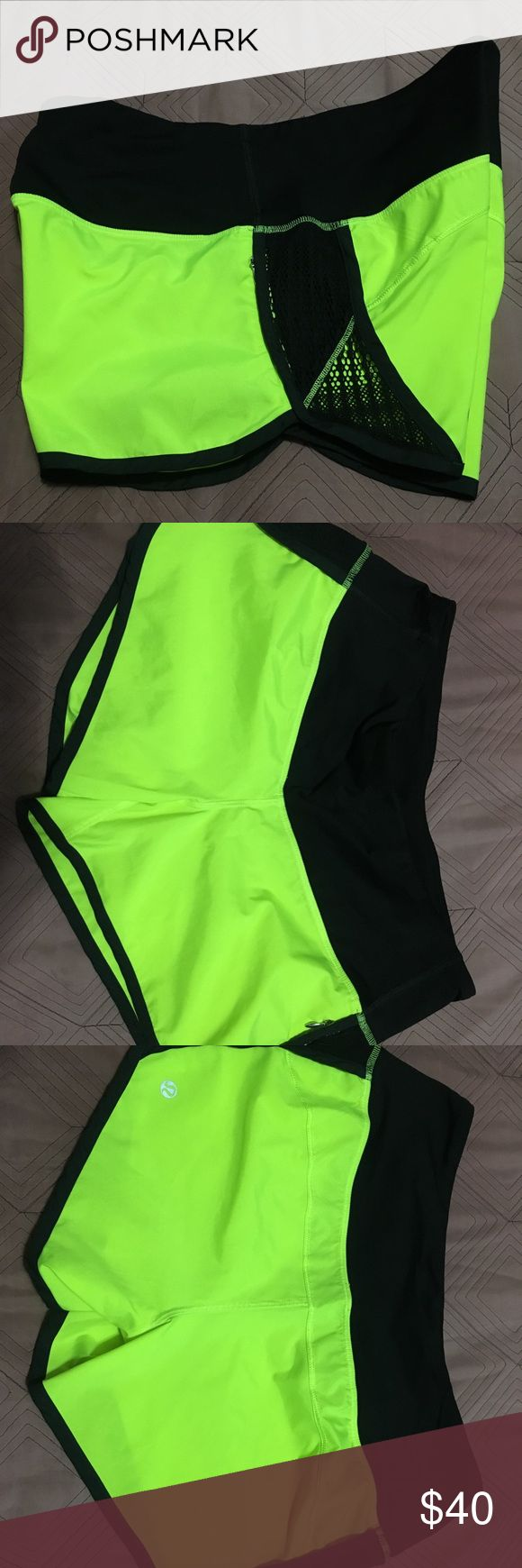 Lululemon Neon Shorts Lululemon shorts with mesh sides and a pocket. Super cute and men bright!!! Very good condition..no tears or stains. No size tag..but I wear a 6 lululemon athletica Shorts