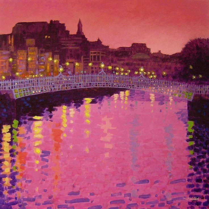 Città e paesi. John Nolan: Crepuscolo: Ponte Ha'penny a Dublino. Acrilico su tela del 2010. locazione sconosciuta. Un incanto di colori al tramonto con lo sky line della città contro il cielo arancio e con le luci che si rispecchiano, dilatandosi, nell'acqua di un colore magico.