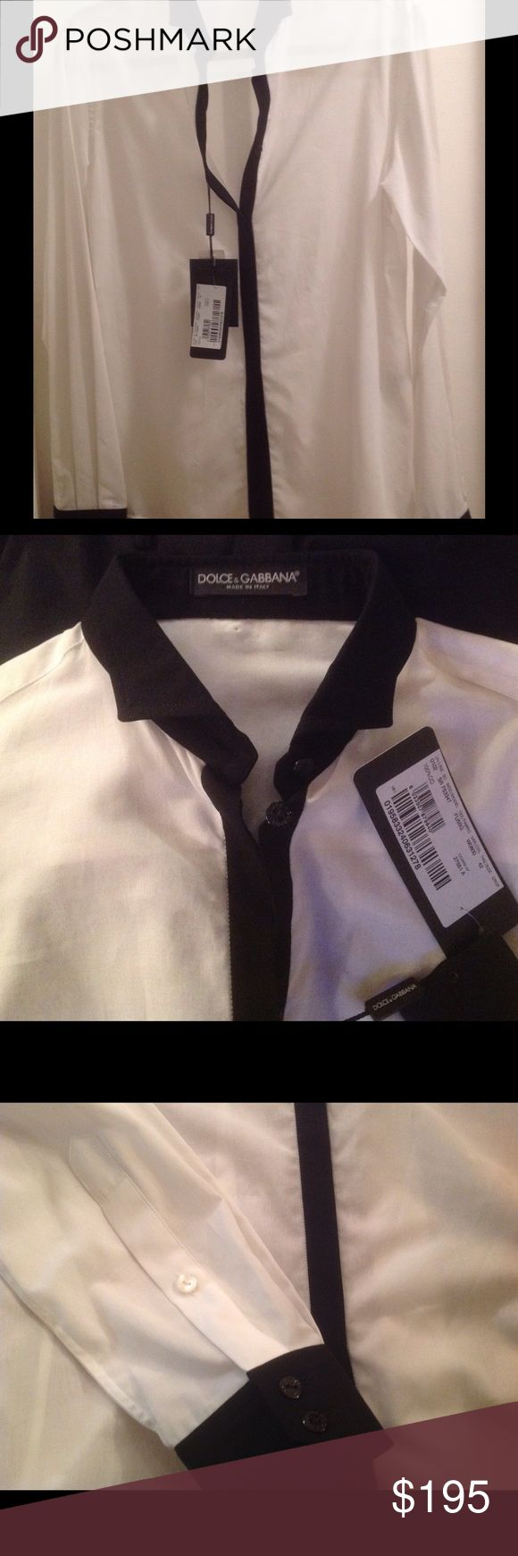 Dolce and Gabbana white and black tuxedo shirt Beautiful cotton shirt by Dolce and Gabbana. Shirt has black tuxedo collar, black cuffs and button line on front! ❤️ Shirt is authentic and brand new! Fabric is very thin and see trough! ❤️ Buttoning is invisible!😊☀️☘🌙Priced to sell! ❤️ 💐☘For exact measurements please refer to official Dolce and Gabbana website! Dolce & Gabbana Tops Button Down Shirts
