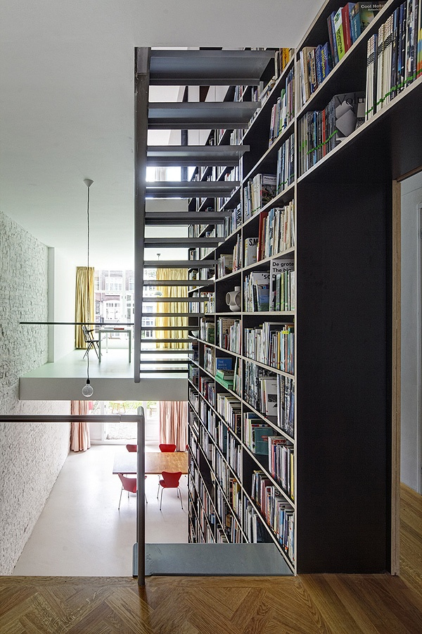Double height book wall/staircase combo.  Vertical Loft in Rotterdam by SHIFT Architecture Urbanism