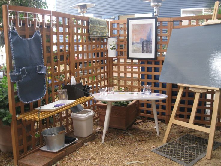 "Another outdoor art area - I like the trellis ("",)"