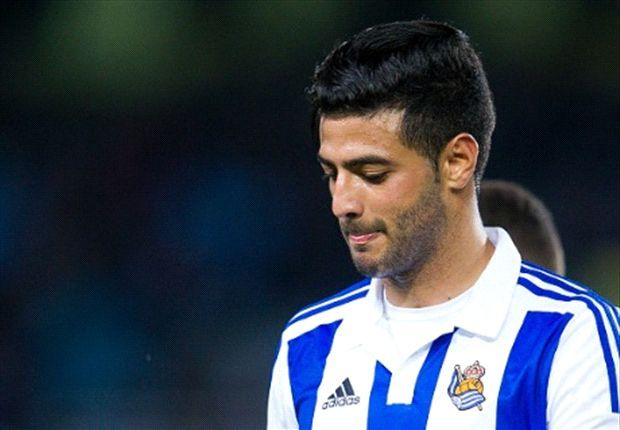 Carlos Vela calls in sick for Real Sociedad training later seen at a Chris Brown concert