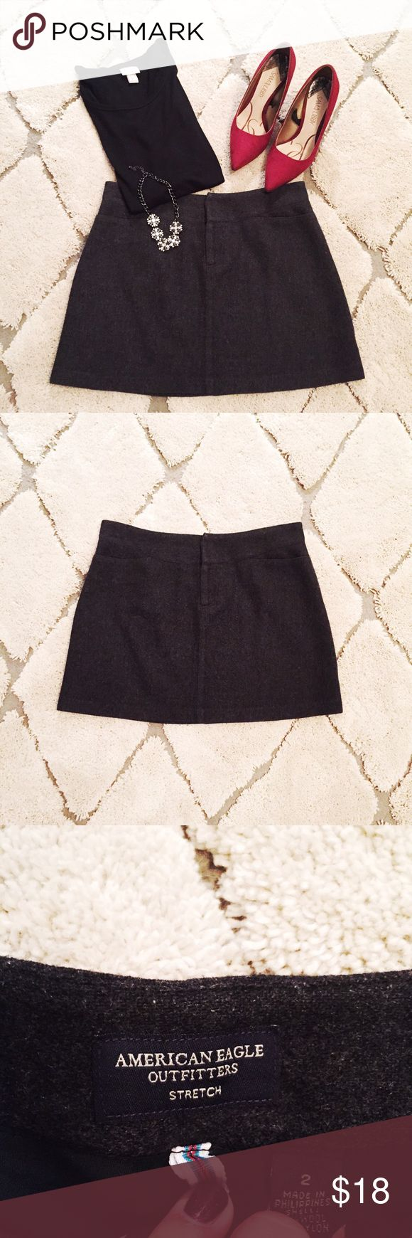 Dark grey wool American Eagle skirt. Size 2 Dark grey American Eagle skirt, size 2. This skirt is such a style staple. Pair with heels and a nice top for work, then slip into some boots for after work happy hour. EUC condition, no marks, tears or stains. Just dry cleaned. Reasonable offers welcome 😃 choker available in separate listing American Eagle Outfitters Skirts