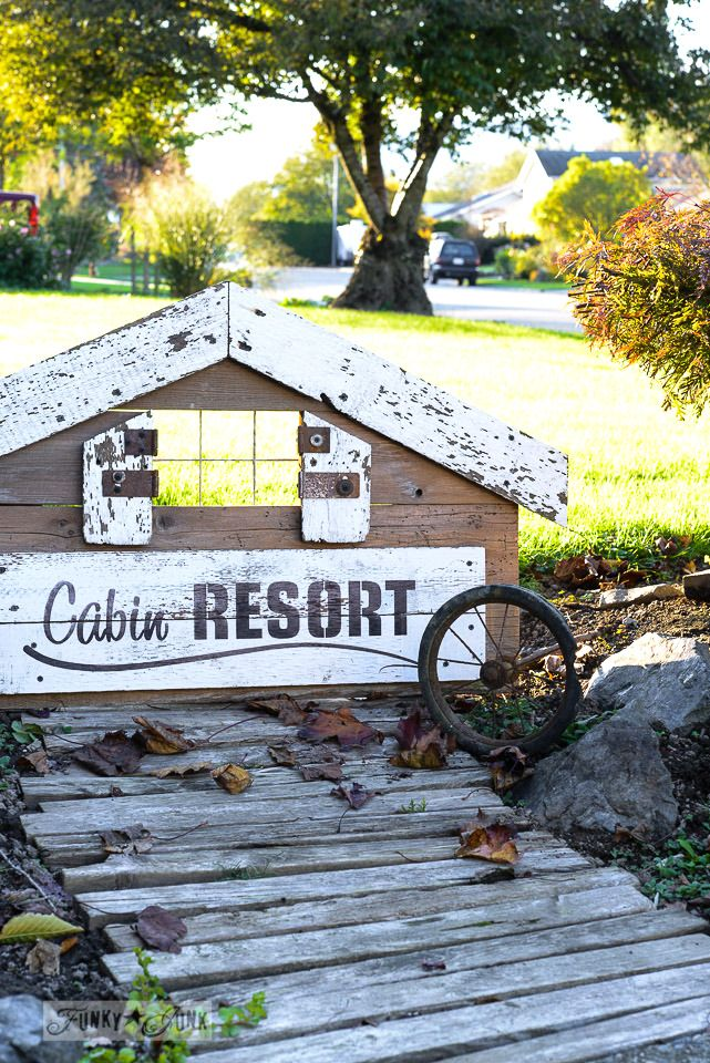 Reclaimed wood stencilled sign for a fall mantel / Cabin Resort from Funky Junk's Old Sign Stencils / funkyjunkinteriors.net