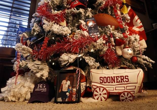 """Mike and Debbie McCurdy's home is decorated for Christmas on Tuesday, Nov. 19, 2013 in Norman, Okla.  The house is on the Assistance League of Norman's holiday home tour.  The """"Game"""" room tree has sports theme.  Photo by Steve Sisney, The Oklahoman"""