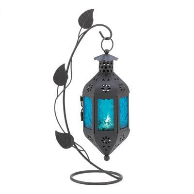 """**NEW PAGAN HOME DECOR @ Eclectic Artisans** At the end of a graceful vine hangs a lantern of purest blue, blazing with color from a petite candle tucked inside. This freestanding lamp makes a stunning appearance no matter where you choose to enjoy it! Weight: 0.8 lbs. Metal, Glass.    3 3/4"""" x 6 1/2"""" x 12 1/4"""" high"""