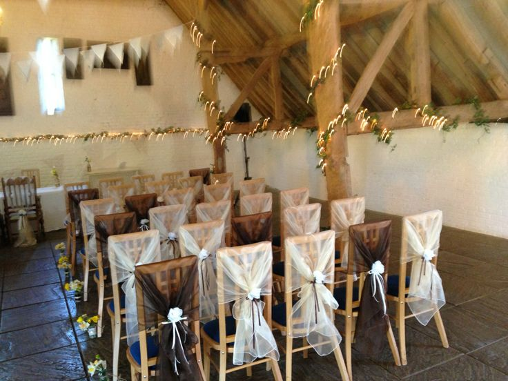 Organza Chair hoods in Ivory and Chocolate Brown with Ribbon and Flower at Ufton Court