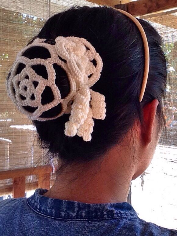 crochet bun cover with flower allique, no pattern but very easy one.