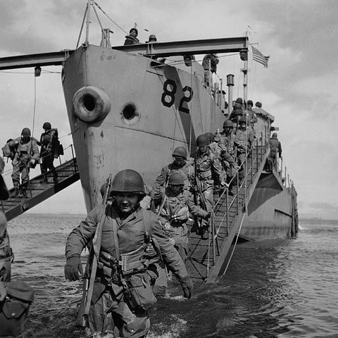 Photograph of Canadian troops disembarking from a ship in the Aleutian Islands