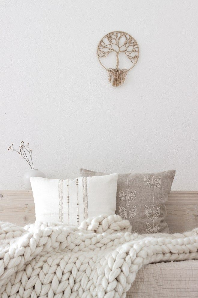 hand embroidered linen pillows look perfect on this neutral background