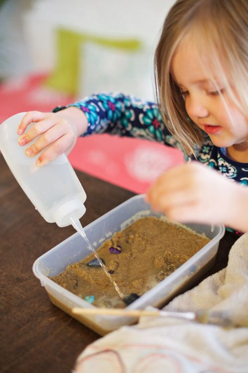 Earth science.  How strong is water?  Have child squirt water slow and fast and watch what happens to the sand.