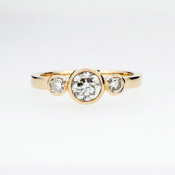 Yellow gold trinity engagement ring with GIA certificated diamond by TorkkeliJewellery