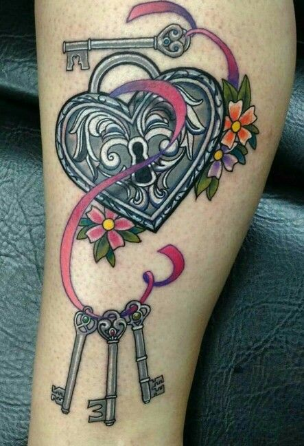 Heart lock and key tattoo by Manuel flowers at next level in Tempe Arizona