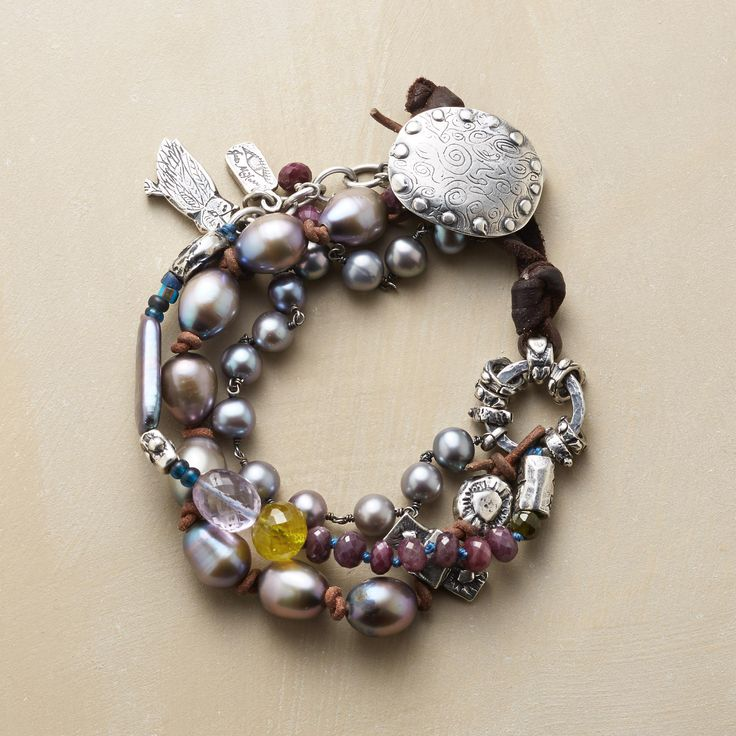BOLD SPIRIT BRACELET. Unabashedly gorgeous, a three-strand bracelet of plump freshwater pearls combined with rubies, garnets, green tourmaline, apatite and sterling silver charms.