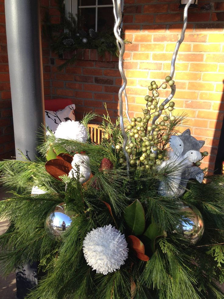 """Neutral """"Woodlands"""" themed urns to welcome friends and family on the porch."""