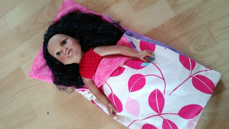Dolly in her new handmade sleeping bag.  I always make something for my daughter's birthday.
