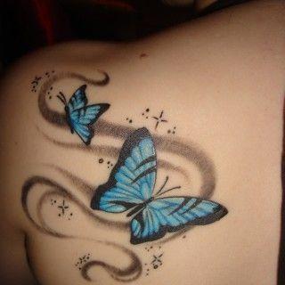 Butterfly, back tattoo on TattooChief.com