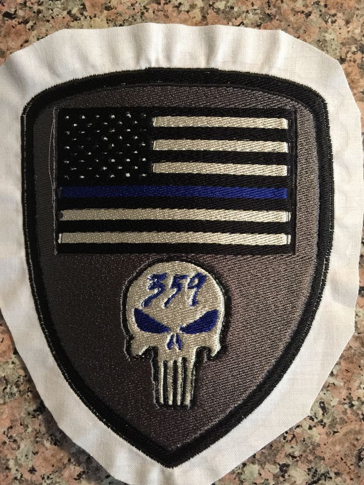 Thin blue line flag with badge number and punisher skull