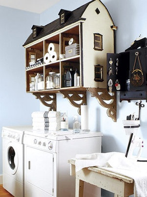 Put things that you love but no longer use, such as this doll house, to playful yet practical use. Anchored to the wall with decorative brackets, it becomes the highlight in an otherwise understated room. Each room of the doll house makes an easy-to-access cubby for laundry supplies.