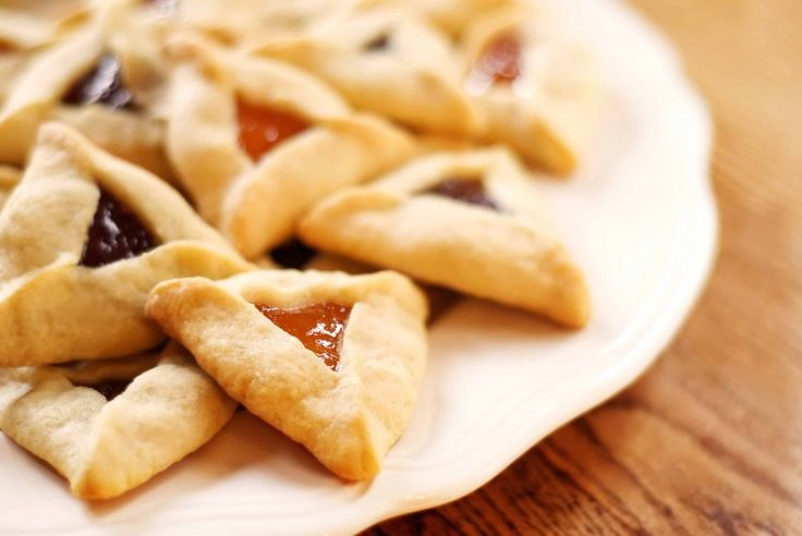 Hamantaschen Cookies  INGREDIENTS: 3/4 cup unsalted butter, room temperature 2/3 cup sugar 1 egg, room temperature 1 tsp vanilla 1 tsp grated orange zest 2 1/4 cups flour 1/4 tsp salt 1-5 tsp water (if needed) 1/4 cup apricot preserves 1/4 cup raspberry preserves 1 egg white, beaten  Double-click image for full recipe and baking tips.