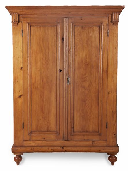 the outswept cornice above a pair of panelled doors enclosing a compartment, on turned tapering legs 196cm high, 140,5cm wide, 55cm deep