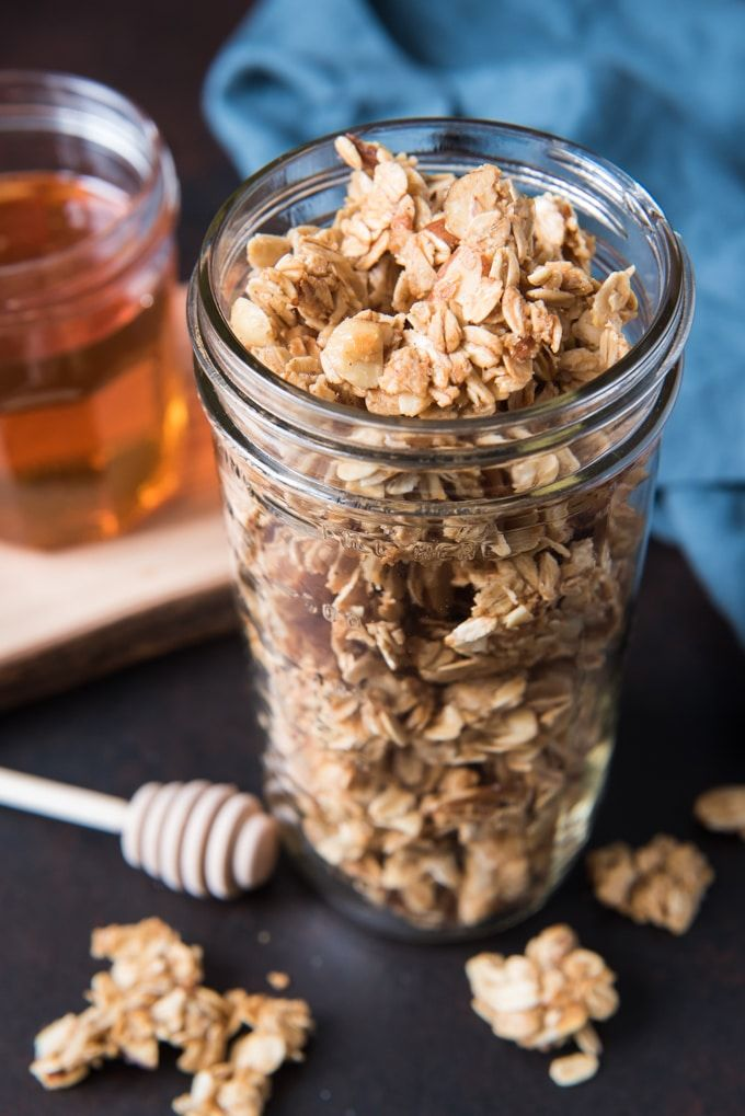 Big, crunchy clusters of lightly sweetened oats and almonds and a touch of cinnamon, brown sugar, vanilla, and honey flavor make this the best, easy homemade granola recipe that our family loves!