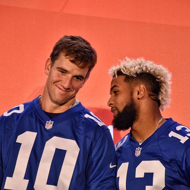 Eli Manning and @ obj of the @ nygiants sharing a private joke onstage at today's @ nfluk Fan Rally at the NFL House on Southampton Row in London. #onlyinthenfl #nfluk #nfl #london #newyork #newyorkgiants #odellbeckhamjr #elimanning #bigblue #nygiants #qb #quarterback #widereceiver #superbowlwinners #mvp