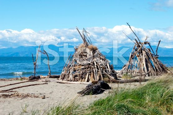 Driftwood Cairns, Motueka Spit, Tasman, New Zealand royalty-free stock photo