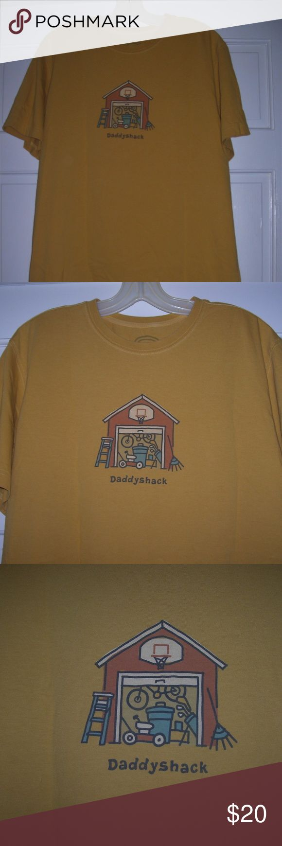 """LIFE IS GOOD Men's Crusher DADDYSHACK Tee *Mustard Men's Life is Good """"Daddyshack"""" crusher tee, size large. Mustard yellow. Front features a garage with open door. Lawn mower, garbage can, golf clubs, and bike inside, rake and step ladder outside. Underneath is written """"Daddyshack."""" Crew neck. Short sleeves. Vintage finish features a faded and worn appearance. 100% cotton. Gently used condition. Life is Good Shirts Tees - Short Sleeve"""