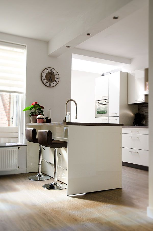 White kitchen with a small bar.