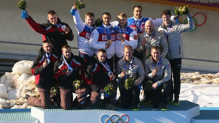 Silver medalist Latvia team 1, gold medalist Russia team 1 and bronze medalist the United States team 1 on the podium during the four-man bobsled Medal Ceremony.