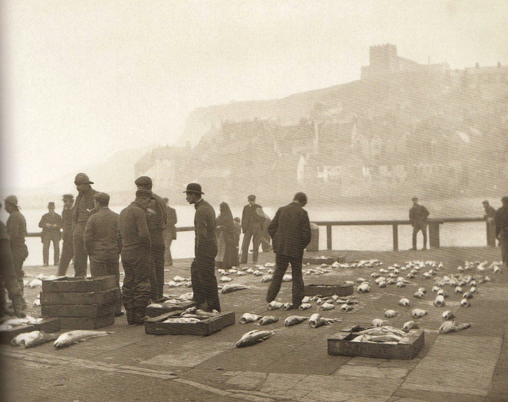 Open-air fish auction at Coffee House Corner - In the background is East Cliff with St Mary's Church on the Horizon - Whitby - England - Late 1800s