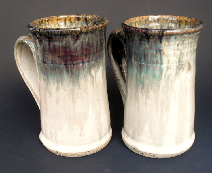 Mugs, thrown stoneware. Dishwasher, oven and microwave safe.